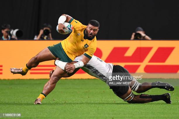TOPSHOT Australia's hooker Silatolu Latu is tackled during the Japan 2019 Rugby World Cup Pool D match between Australia and Fiji at the Sapporo Dome...