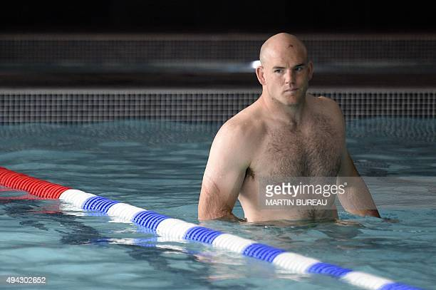Australia's hooker Stephen Moore attends a team recovery session at a swimming pool in Teddington west London on October 26 2015 after their victory...