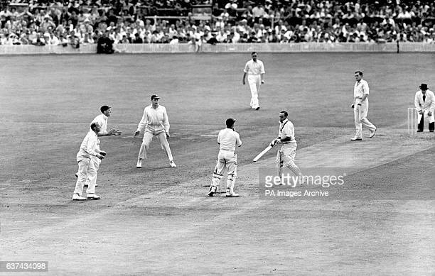 Australia's Ian Johnson is bowled by England's Jim Laker for a duck