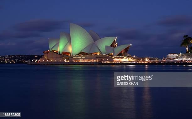Australia's iconic Sydney Opera House is lit with green lights to mark St Patrick's Day in Sydney on March 17 2013 From Egypt's pyramids to the...