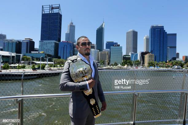Australia's inaugral UFC champion Robert Whittaker poses with championship belt at Elizabeth Quay on December 12 2017 in Perth Australia