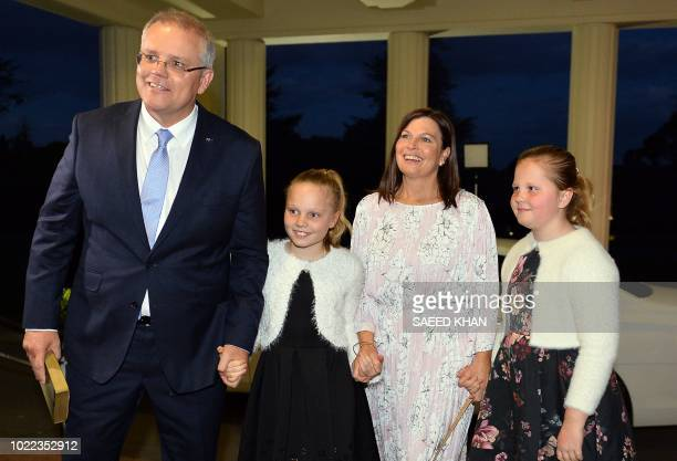Australia's incoming Prime Minister Scott Morrison arrives with his wife Jenny Morrison and their daughters Abbey and Lily at Government House for...