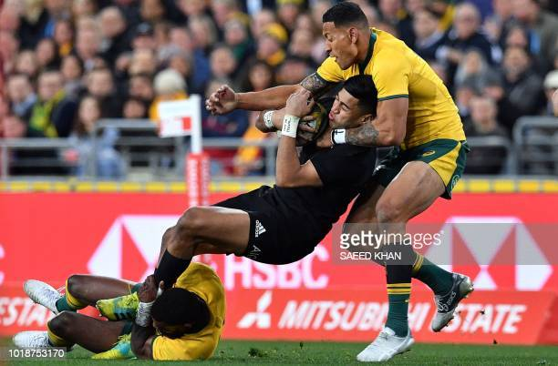TOPSHOT Australia's Israel Folau and Kurtley Beale tackle New Zealand's Rieko Ioane during their Rugby Championship Bledisloe Cup match in Sydney on...