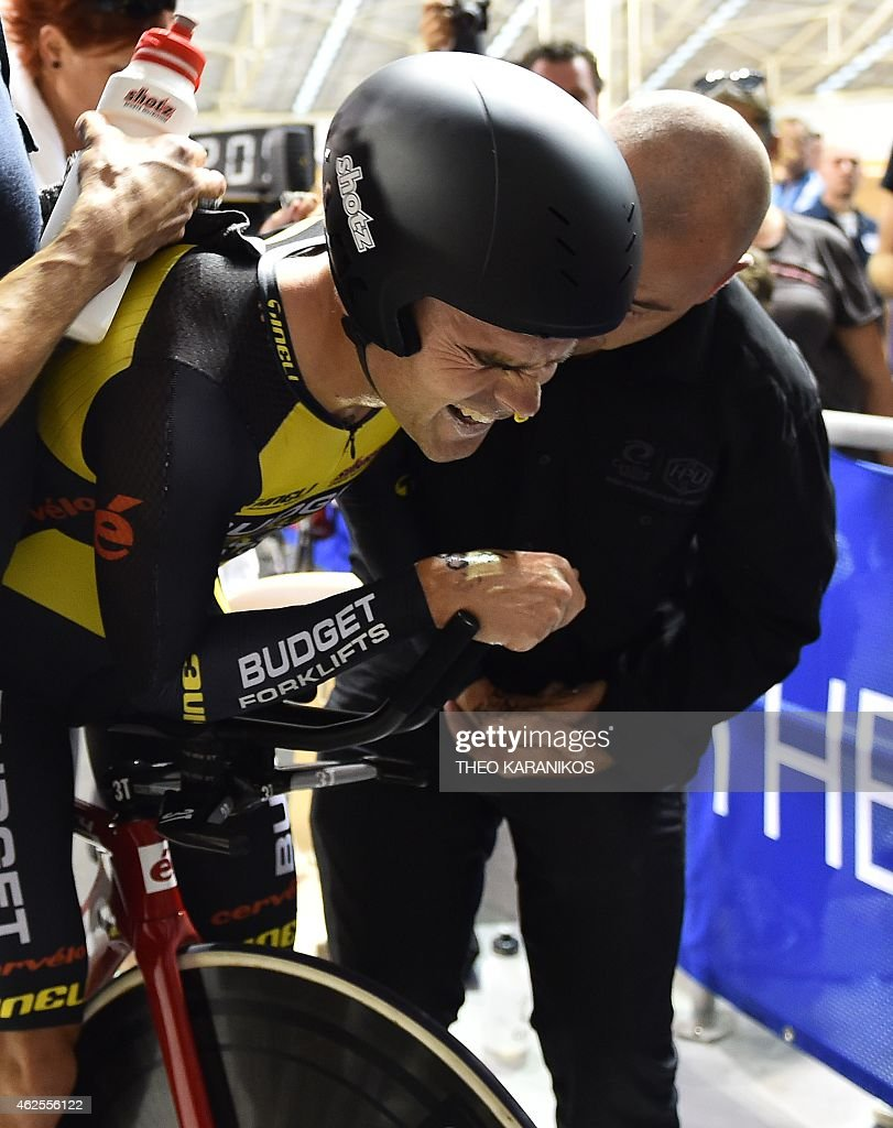 Australia's Jack Bobridge reacts in pain after his world record attempt to ride the furthest in one hour at the Darebin International Sports Centre in Melbourne on January 31, 2015. AFP PHOTO / Theo KARANIKOS USE