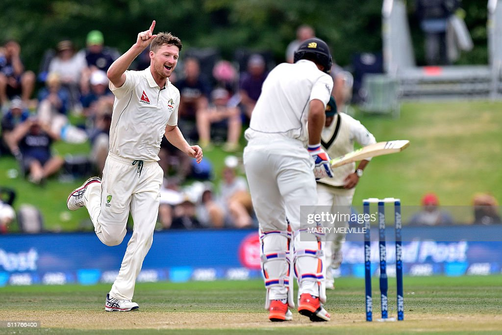Australia's Jackson Bird (L) celebrates New Zealand's Tim Southee (R) being caught during day four of the second cricket Test match between New Zealand and Australia at the Hagley Park in Christchurch on February 23, 2016. AFP PHOTO / MARTY MELVILLE / AFP / Marty Melville