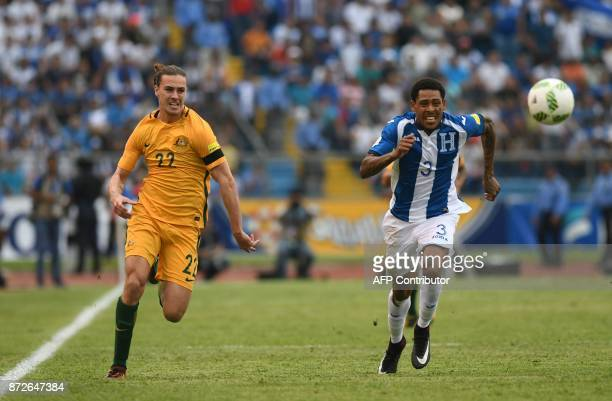 Australia's Jackson Irvine and Honduras' Henry Figueroa run for the ball during the first leg football match of their 2018 World Cup qualifying...