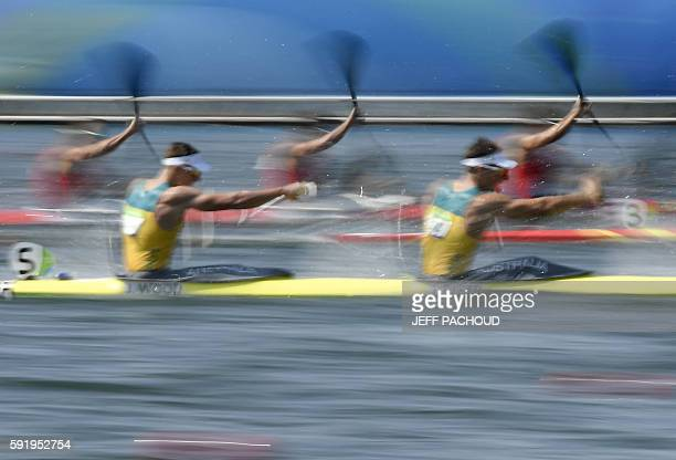 TOPSHOT Australia's Jacob Clear and Australia's Jordan Wood compete in the Men's Kayak Four 1000m semifinal at the Lagoa Stadium during the Rio 2016...