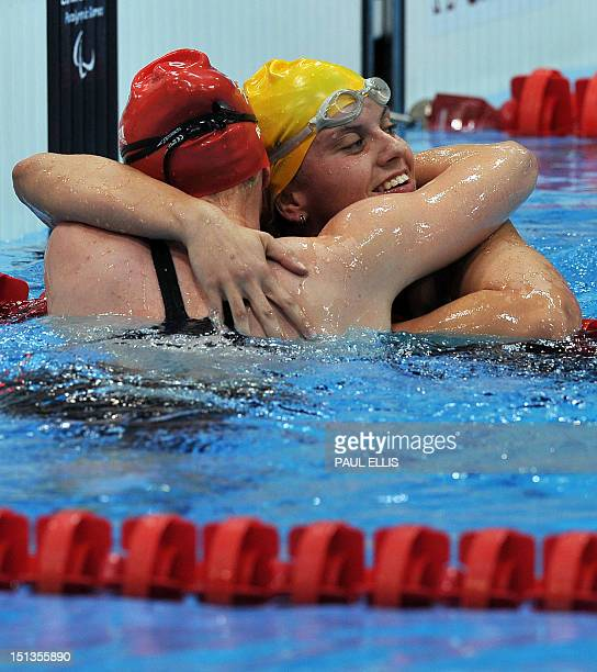 Australia's Jacqueline Freney embraces Britain's Susannah Rodgers after winning and setting a new world record in the women's 400m freestyle S7...