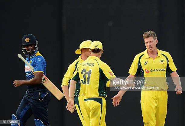 Australia's James Faulkner celebrates with his teammates after he dismissed Sri Lanka's Thisara Perera during the second oneday International cricket...