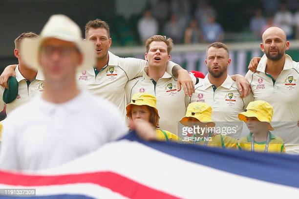 Australia's James Pattinson, Steve Smith, Matthew Wade and Nathan Lyon sing the national anthem during the first day of the third cricket Test match...