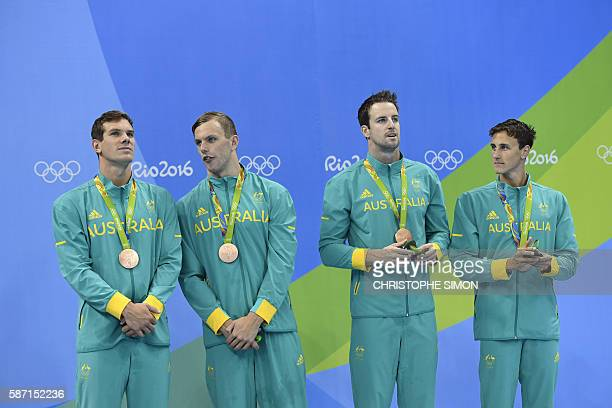 Australia's James Roberts Australia's Kyle Chalmers Australia's James Magnussen and Australia's Cameron McEvoy pose with their bronze medals on the...