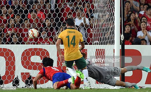Australia's James Troisi scores a goal against South Korea in the first half of the extra time during the AFC Asian Cup football final between South...