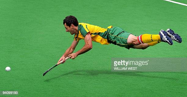 Australia's Jamie Dwyer flicks the ball towards the Spanish goal during their Champions Trophy field hockey match, in Melbourne on December 5, 2009....