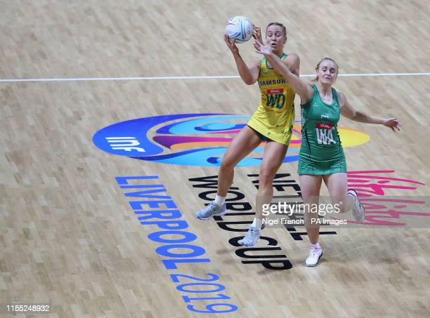 Australia's JamieLee Price and Northern Ireland's Lisa McCaffrey battle for the ball during the Netball World Cup match at the MS Bank Arena Liverpool