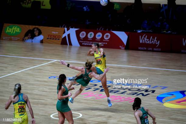 Australia's JamieLee Price clashes with Northern Ireland's Caroline O'Hanlon who needed treatment after the clash during the Netball World Cup match...