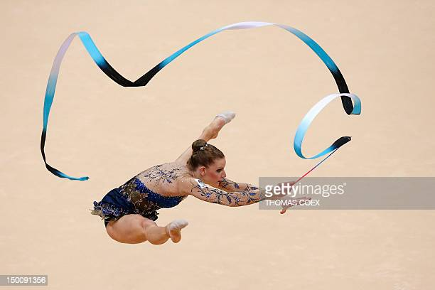 Australia's Janine Murray performs her ribbon program during the individual all-around qualifications of the rythmic gymnastics event of the London...