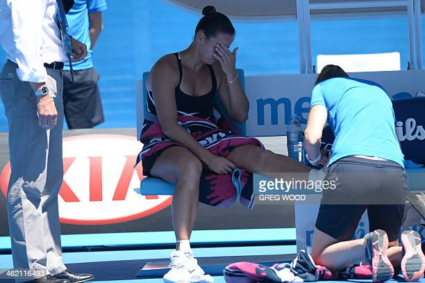 Australia's Jarmila Gajdosova reacts as she receives treatment after falling to the court during her women's singles match against Germany's...