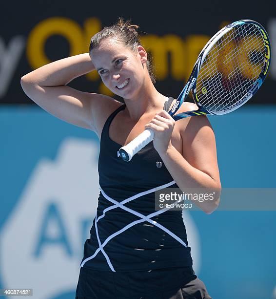 Australia's Jarmila Gajdosova reacts during her first round match with Lauren Davis of the US at the APIA Sydney International tennis tournament on...