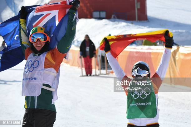 Australia's Jarryd Hughes and Spain's Regino Hernandez celebrate after the men's snowboard cross big final at the Phoenix Park during the Pyeongchang...