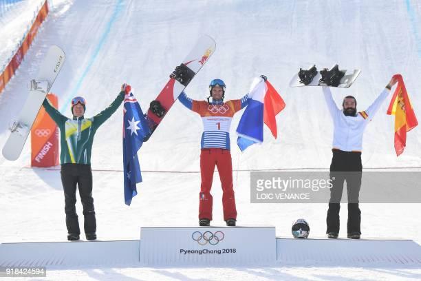Australia's Jarryd Hughes, France's Pierre Vaultier and Spain's Regino Hernandez celebrate on the podium after the men's snowboard cross big final at...