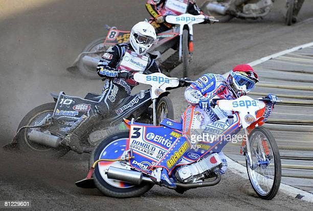 Australia's Jason Crump leads ahead of Sweden's Andreas Jonsson during their speedway Grand Prix race at Ullevi Arena on May 24 in Goteborg Sweden...