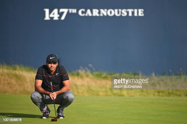 Australia's Jason Day lines up a putt on the 18th green during his first round on day one of The 147th Open golf Championship at Carnoustie Scotland...
