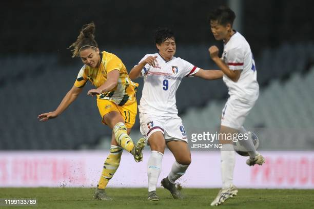 Australias Jenna McCormick shoots under pressure from Taiwan's Lee Hsuchin during the women's Olympic football tournament qualifier match between...