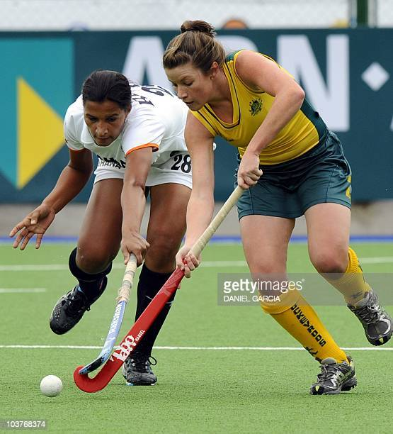 Australia's Jenner Kate battles for the ball with India's Rani Rampal during the field hockey Group A match for the Women World Cup 2010 in Rosario...