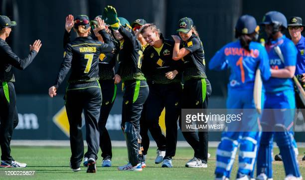 Australia's Jess Jonassen is congratulated by teammates after taking her fifth Indian wicket in the final of their women's T20 international...