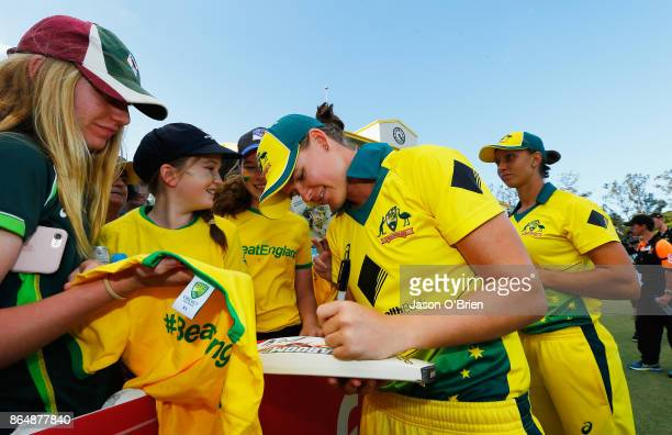 Australia's Jess Jonassen signs autographs during the Women's One Day International between Australia and England at Allan Border Field on October 22...