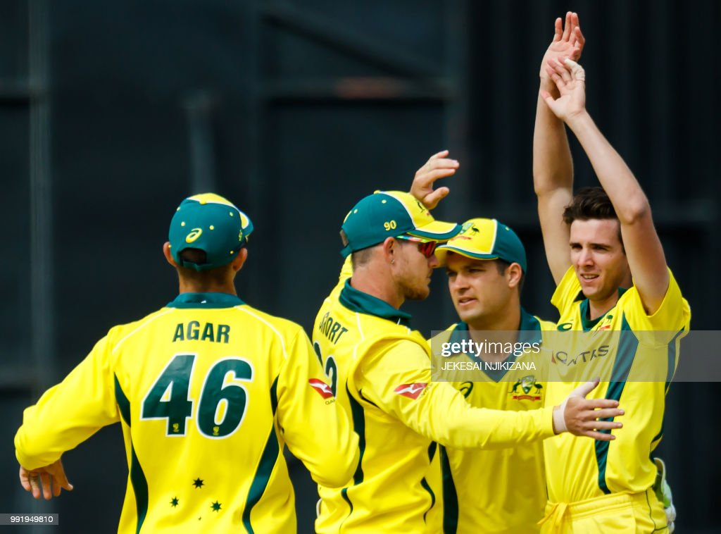 Australia's Jhye Richardson (R) celebrates with teammates after taking a wicket during the fifth T20 cricket match between Pakistan and Australia, one of a T20 tri-series including host nation Zimbabwe, at The Harare Sports Club in Harare on July 5, 2018.
