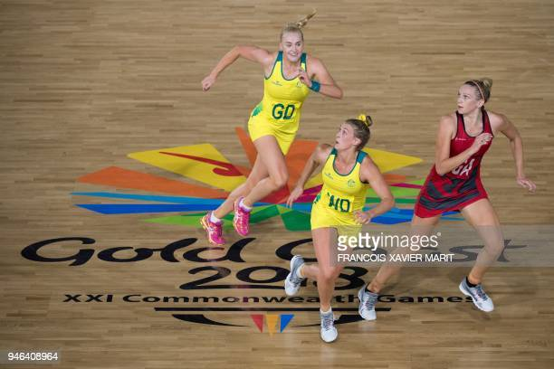 Australia's Joanna Weston Gabi Simpson and England's Serena Guthrie compete for the bale during their women's field netball gold medal match against...
