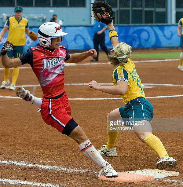 Australia's Jodie Bowering takes the throw ahead of runner Eri Yamada of Japan in the bottom of the fourth inning during their 2008 Beijing Olympic...