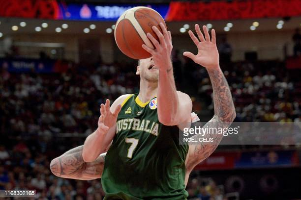 TOPSHOT Australia's Joe Ingles goes to the basket during the Basketball World Cup third place game between France and Australia in Beijing on...
