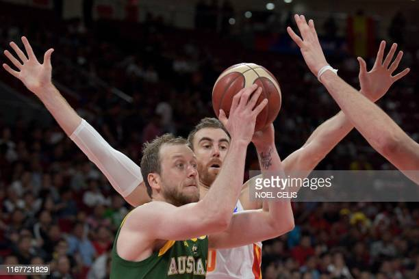 Australia's Joe Ingles takes a shot as Spain's Victor Claver tries to block during the Basketball World Cup semifinal game between Australia and...