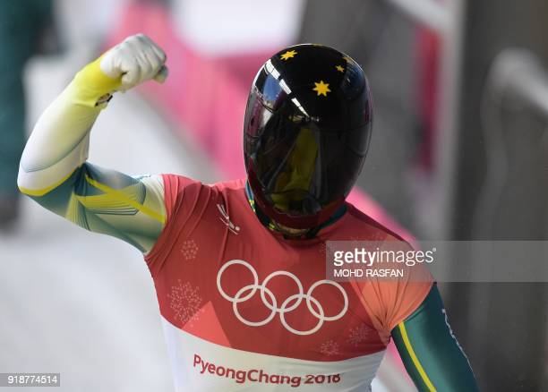 Australia's John Farrow celebrates after finishing the mens's skeleton heat 3 run during the Pyeongchang 2018 Winter Olympic Games at the Olympic...