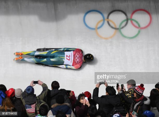 Australia's John Farrow competes in the mens's skeleton heat 3 run during the Pyeongchang 2018 Winter Olympic Games at the Olympic Sliding Centre on...