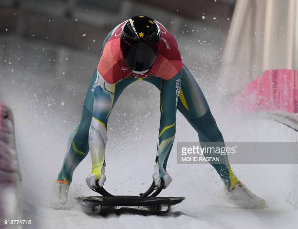 Australia's John Farrow slows down at the end of the mens's skeleton heat 3 run during the Pyeongchang 2018 Winter Olympic Games at the Olympic...