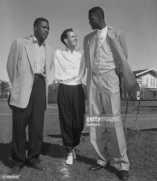 Australia's John Landy world record holder for the mile meets All American basketball players Bill Russell and Casey Jones of the U of San Francisco...