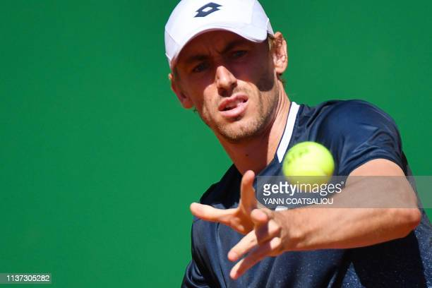 Australia's John Millman eyes the ball before playing a forehand return Spain's Roberto Bautista Agut during their tennis match on the day 3 of the...