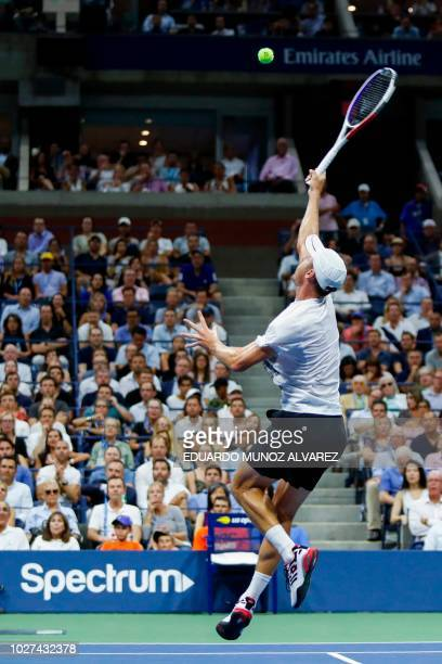 Australia's John Millman hits a return to Serbia's Novak Djokovic during their Men's Singles QuarterFinals match at the 2018 US Open at the USTA...