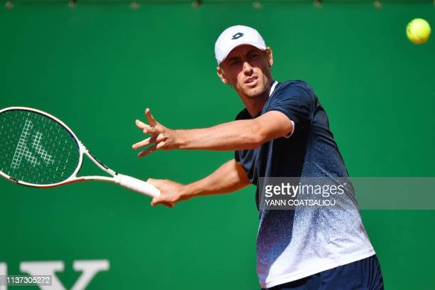 Australia's John Millman plays a forehand return Spain's Roberto Bautista Agut during their tennis match on the day 3 of the MonteCarlo ATP Masters...
