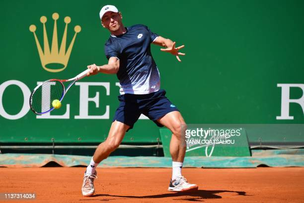 Australia's John Millman plays a forehand return to Spain's Roberto Bautista Agut during their tennis match on the day 3 of the MonteCarlo ATP...