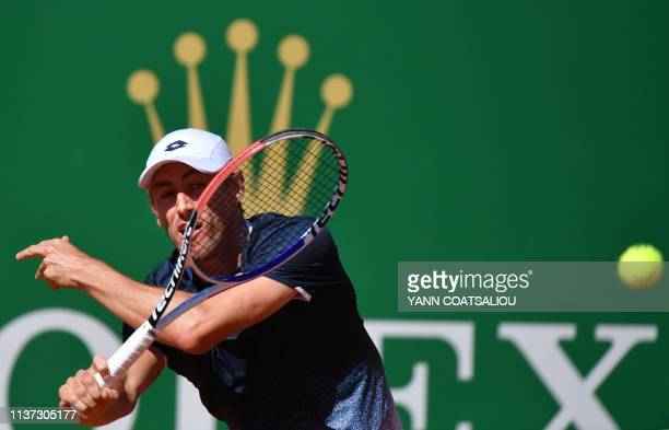 Australia's John Millman plays a return to Spain's Roberto Bautista Agut during their tennis match on the day 3 of the MonteCarlo ATP Masters Series...