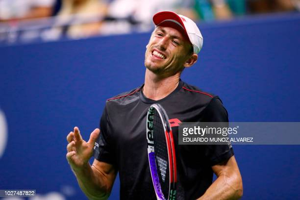 Australia's John Millman reacts after losing a point to Serbia's Novak Djokovic during their Men's Singles QuarterFinals match at the 2018 US Open at...