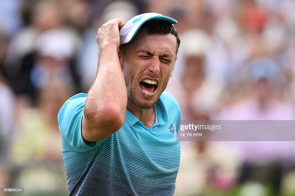 TOPSHOT - Australia's John Millman reacts after missing a point against Serbia's Novak Djokovic during their first round men's singles match at the ATP Queen's Club Championships tennis tournament in west London on June 19, 2018. - Djokovic won 6-2, 6-1.