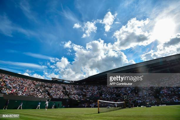 Australia's John Millman returns against Spain's Rafael Nadal during their men's singles first round match on the first day of the 2017 Wimbledon...