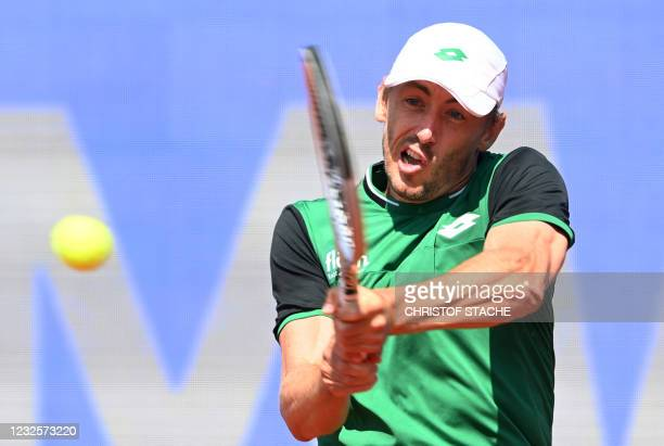 Australia's John Millman returns the ball to Argentina's Guido Pella during their match of the ATP men's tennis BMW Open in Munich, southern Germany,...