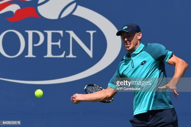 Australia's John Millman returns the ball to Australia's Nick Kyrgios during their Qualifying Men's Singles match at the 2017 US Open Tennis...