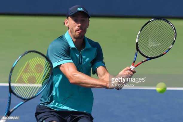 Australia's John Millman returns the ball to Australia's Nick Kyrgios in their Qualifying Men's Singles match at the 2017 US Open Tennis Tournament...